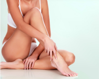 Lady showing smooth legs after laser hair removal treatment
