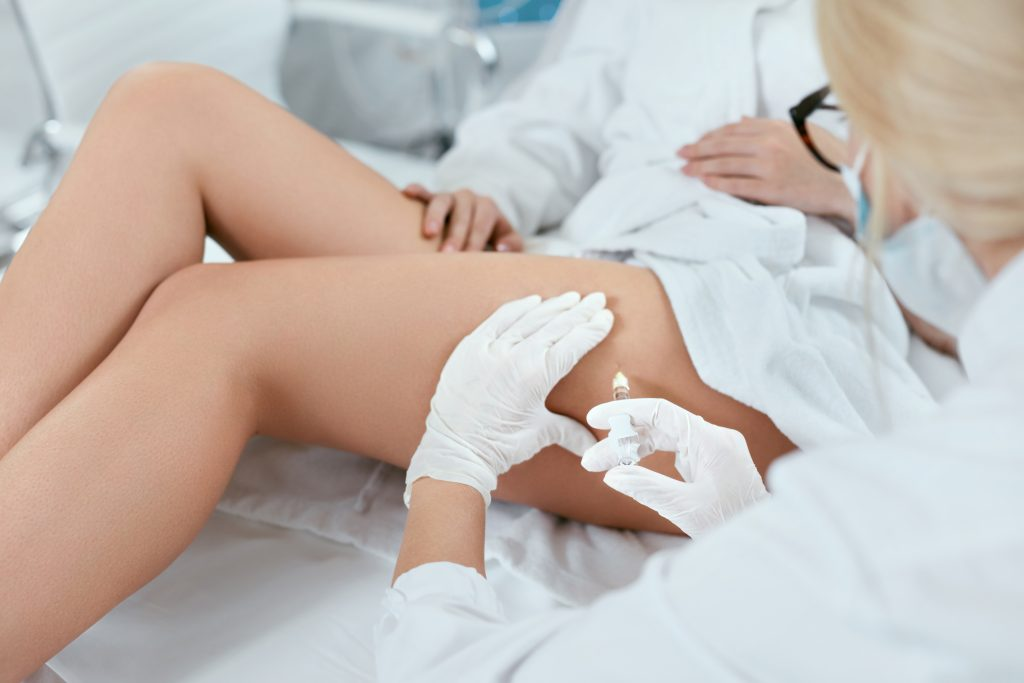Aesthetician treating patients thighs with aqualyx fat dissolving injections