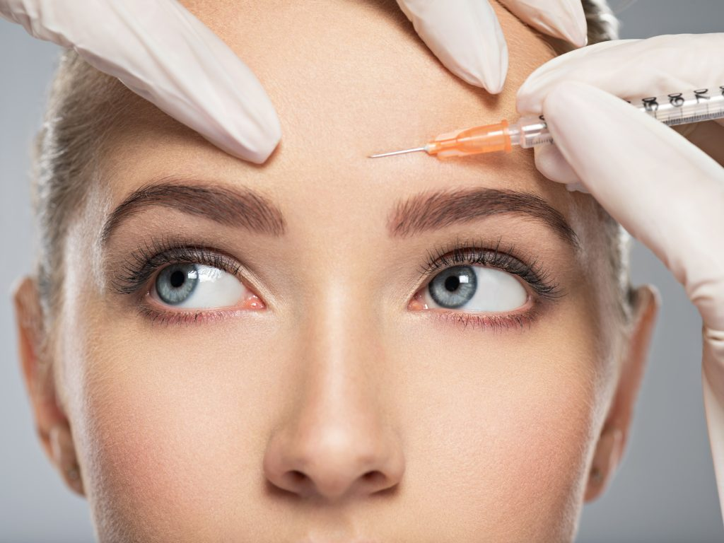 Woman getting Botox injections to soften frown lines