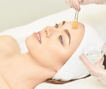 Aesthetician applying chemical peel facial