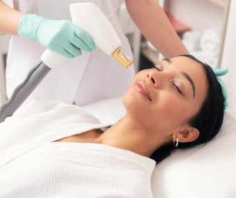 Aesthetician using an ND-YAG laser to perform a laser lift and plump facial